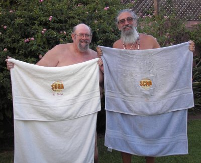 Two SCNA members displaying their SCNA Logo towels