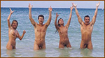 Four nude swimmers in the surf